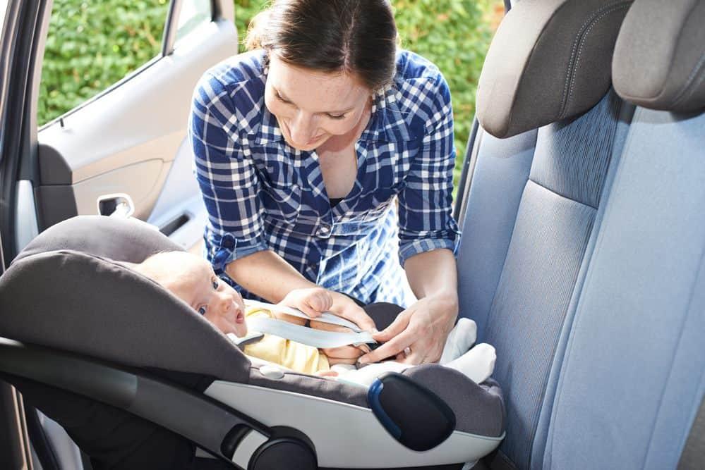 newborn in car